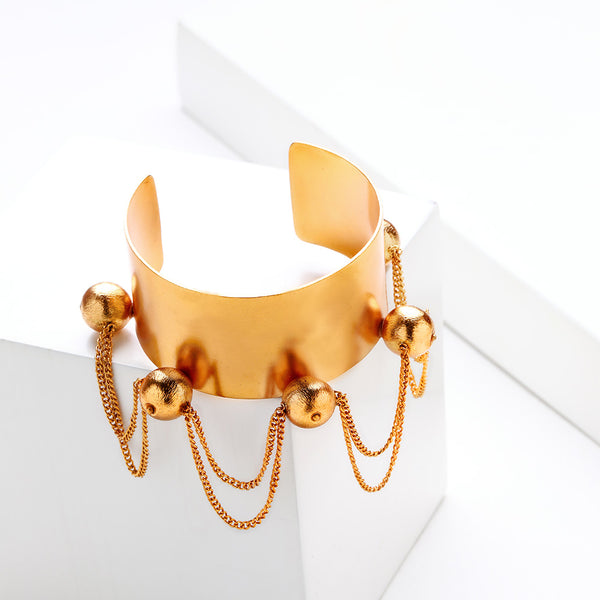 Gold Toned Broad Cuff with Ball & Tassel Details