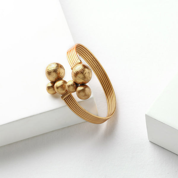 Gold Toned Lines Wrap Cuff with Ball Clusters