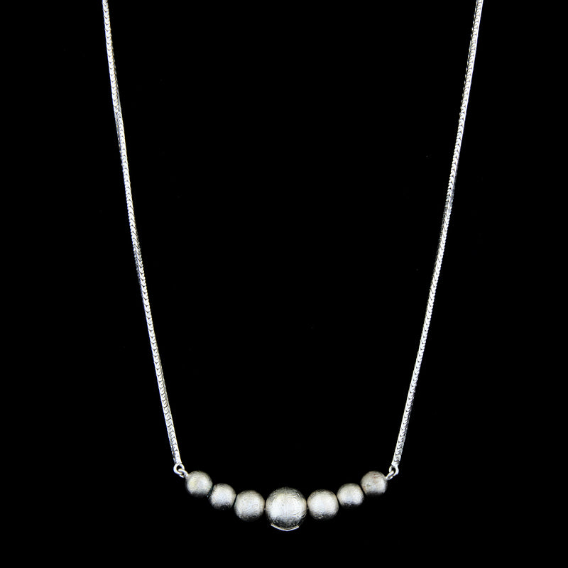 silver toned necklace with chain necklace and ball pendant