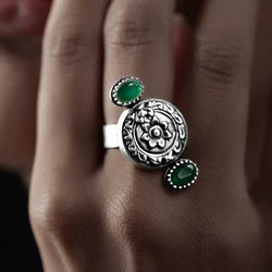 Sterling Silver Floral Motif Ring with Two Green Crystals
