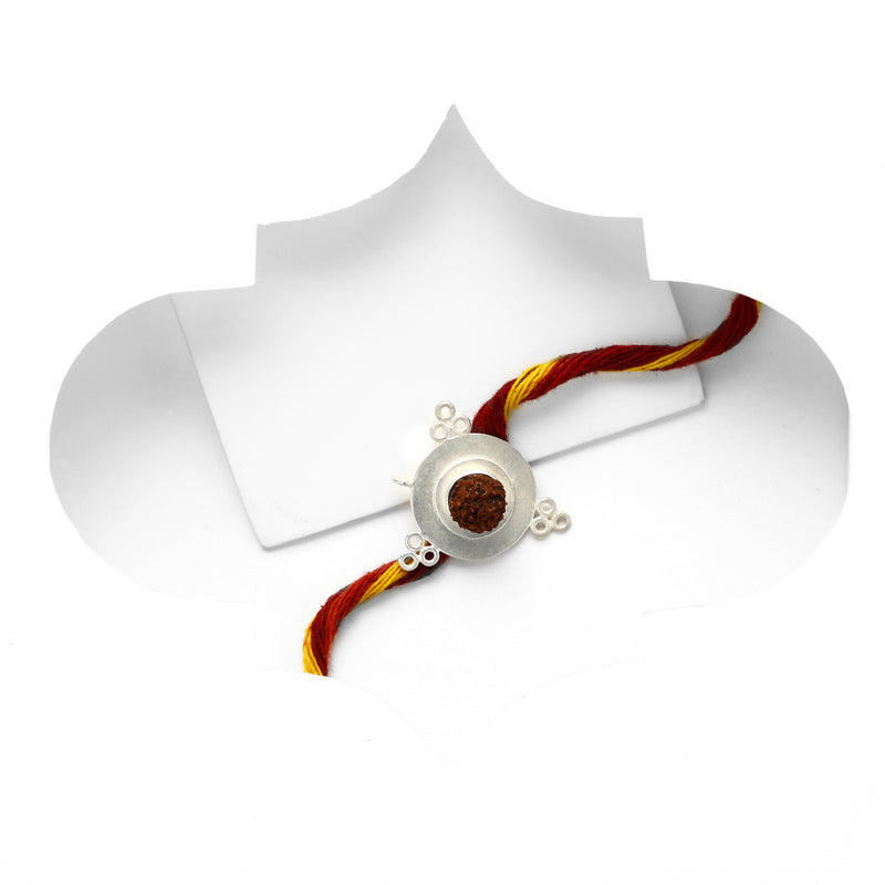 SILVER TONED CIRCULAR CONVERTIBLE RAKHI WITH RUDRAKSHA BEAD