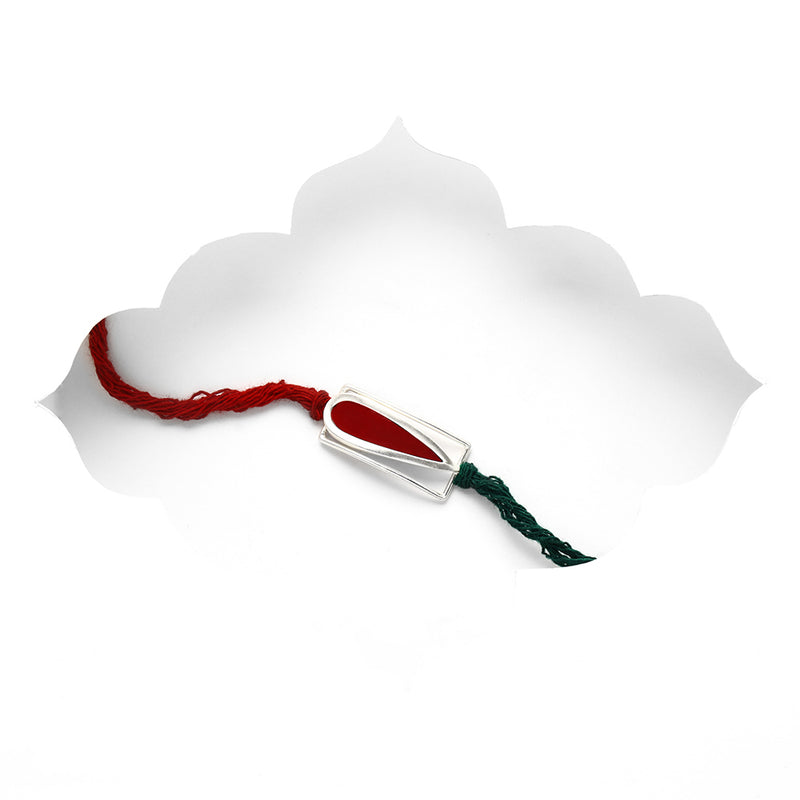 SILVER TONED RECTANGULAR DROPLET RAKHI WITH RED LEATHER INSERT