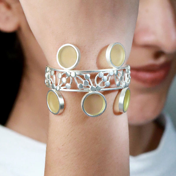 SILVER TONED DOTTED CUFF WITH CHARTREUSE ACRYLIC CIRCLES