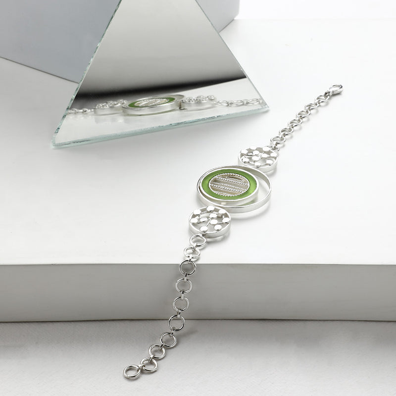 SILVER TONED BRACELET WITH CHARTREUSE ACRYLIC TANGENT & DOTTED CIRCLES