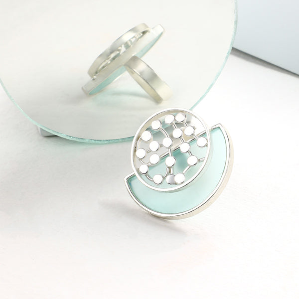 SILVER TONED CYAN ACRYLIC ARC RING WITH OVERLAID DOTTED CIRCLE
