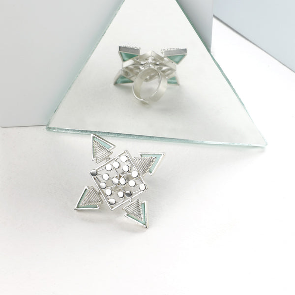 SILVER TONED DOTTED RHOMBUS RING WITH COILED CYAN ACRYLIC TRIANGLES