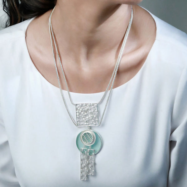 SILVER TONED LAYERED NECKLACE WITH CYAN ACRYLIC CIRCLE & DOTTED BLOCK PENDANTS