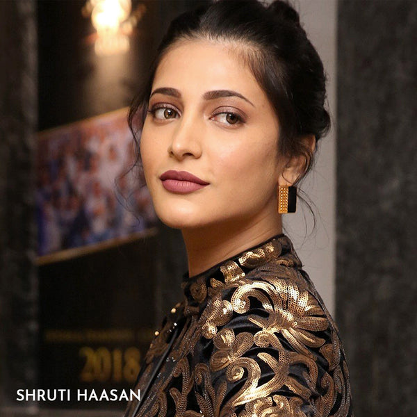 Gold Toned Rectangle Perspex Stud Earrings With Beaten Metal Detail Worn By Shruti Haasan