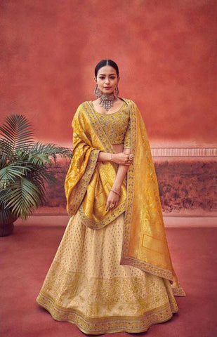 Elegant Yellow and Off White Silk Wedding Wear Lehenga