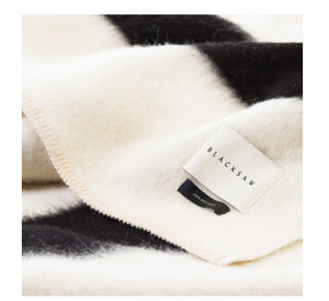 THE SIEMPRE RECYCLED BLANKET IN IVORY AND BLACK