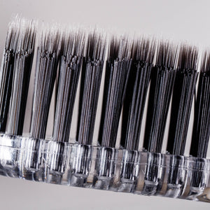 TOOTHBRUSH, WHITE WITH BLACK BRISTLES