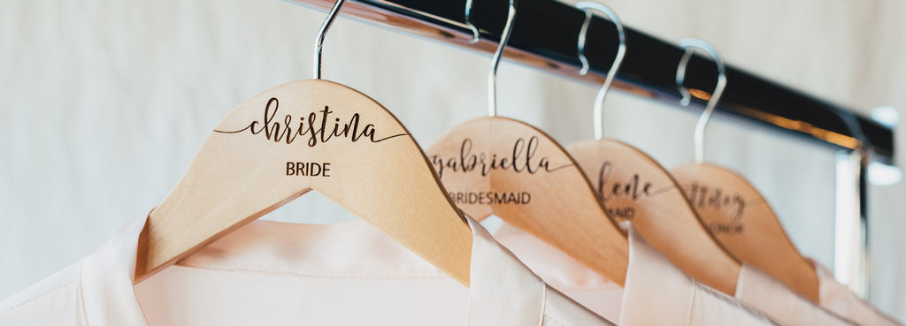 white wooden engraved bridesmaid hangers