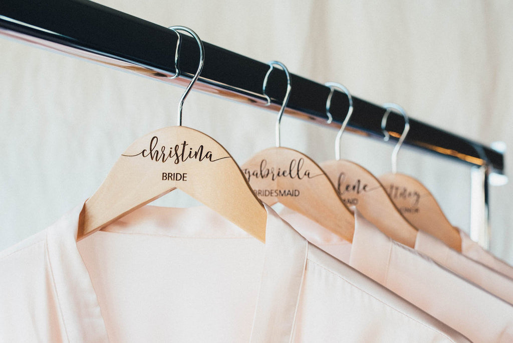 Bridesmaid wooden hangers with personalization engraved with the bridal parties custom names