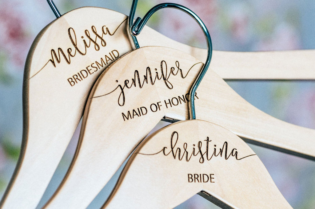A Set Of Personalized Wooden Bridesmaid Hangers