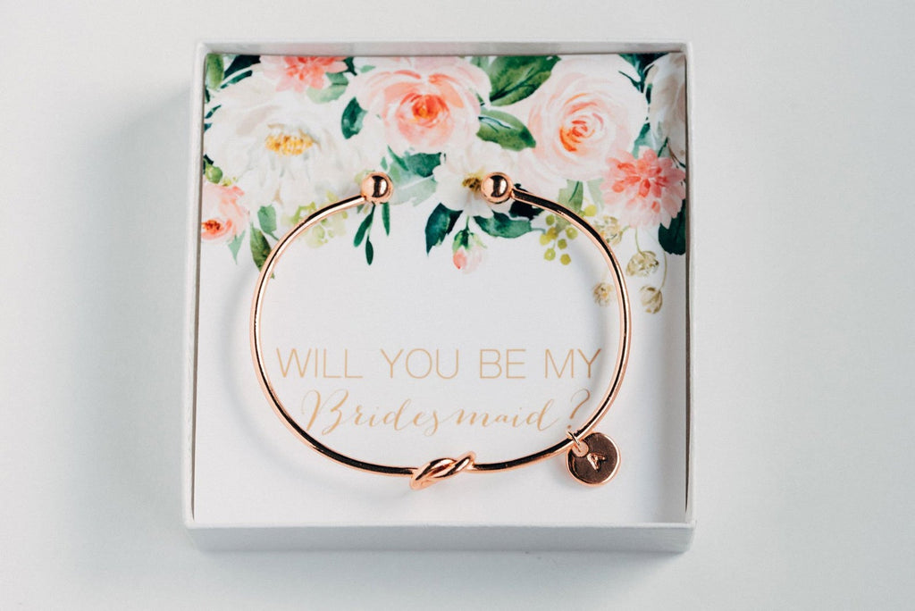 "Golden personalized bridesmaid proposal bracelet with a initial charm in a box that says ""Will you be my bridesmaid?"""