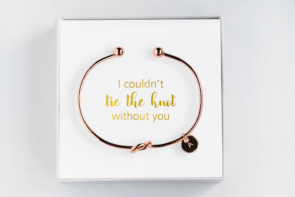 "Golden personalized bridesmaid proposal bracelet with a initial charm in a box that says ""I couldn't tie the knot without you"""
