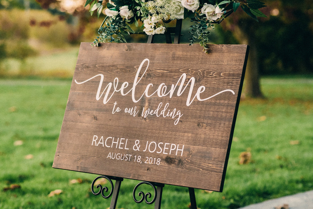 Personalized wooden wedding welcome to our wedding sign with vinyl decal