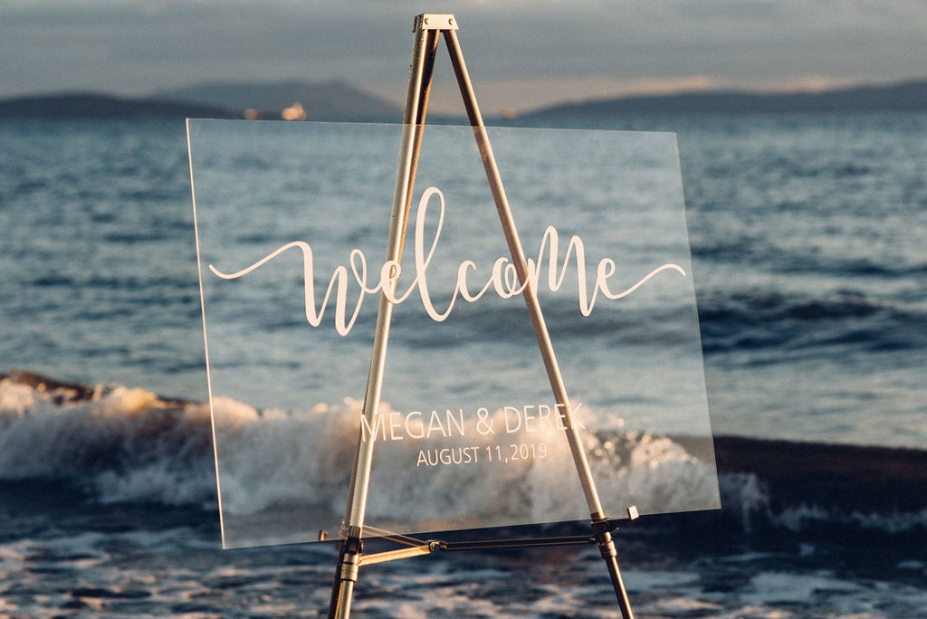 Acrylic wedding welcome sign with vinyl decal at a beach style wedding