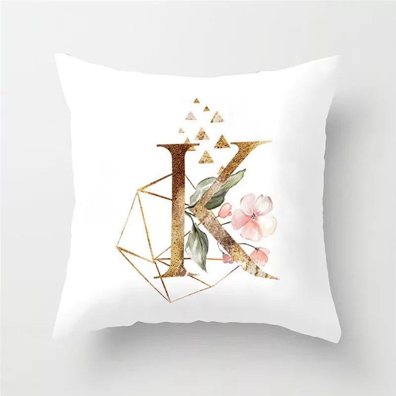 Gold initial cushion cover