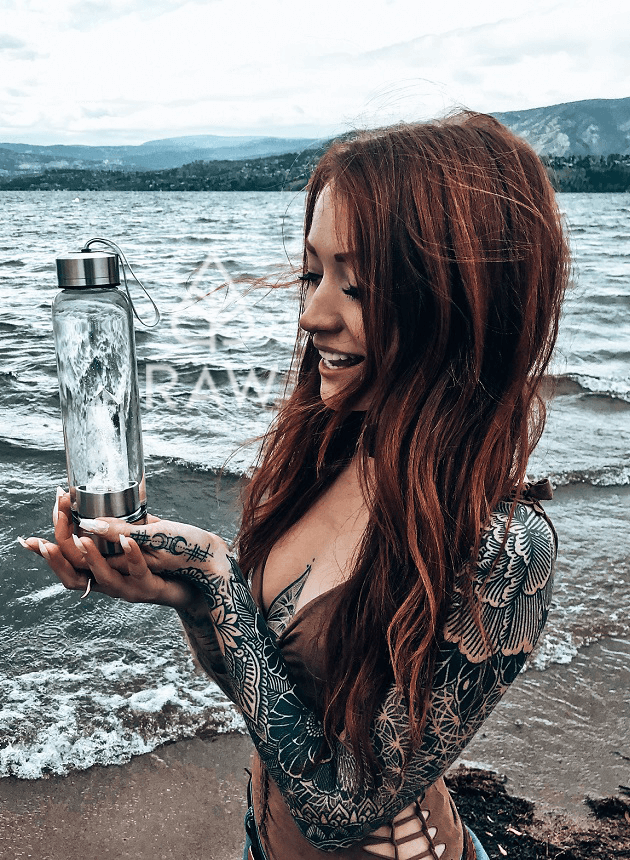 Raw Living Essentials co founder Crystal Ashley holding Clear Quartz Crystal Water Bottle
