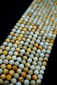 "Fossil Coral (Round)(Faceted)(16""Strand)"