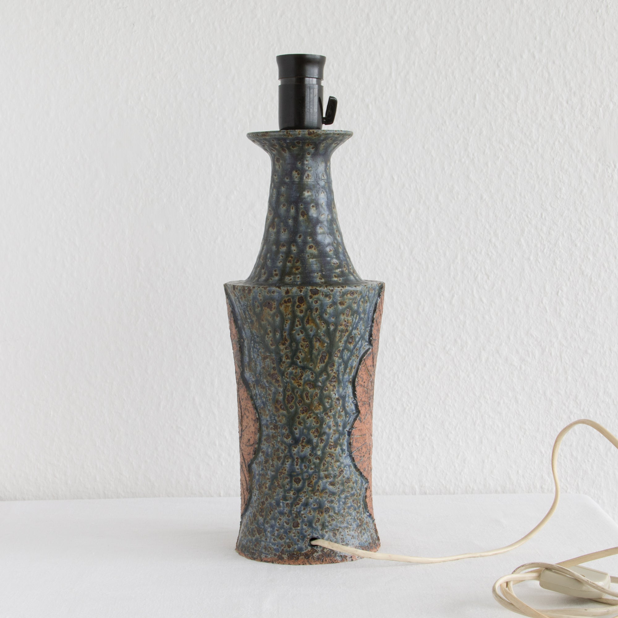 LENE REGIUS Nautilus Patterned Dark Blue Glazed Black Speckled Stoneware Table Lamp - Mollaris.com