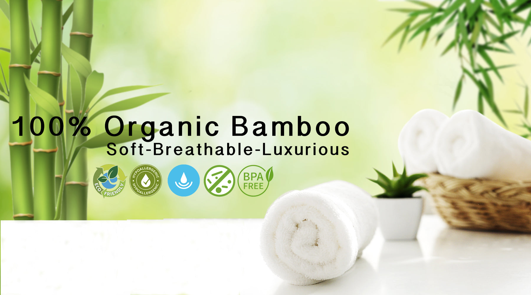 100% organic bamboo towels banner with a bamboo plant and towels in a basket
