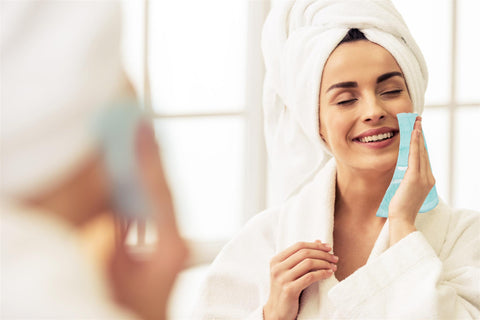woman cleaning face with face towels   towelogy