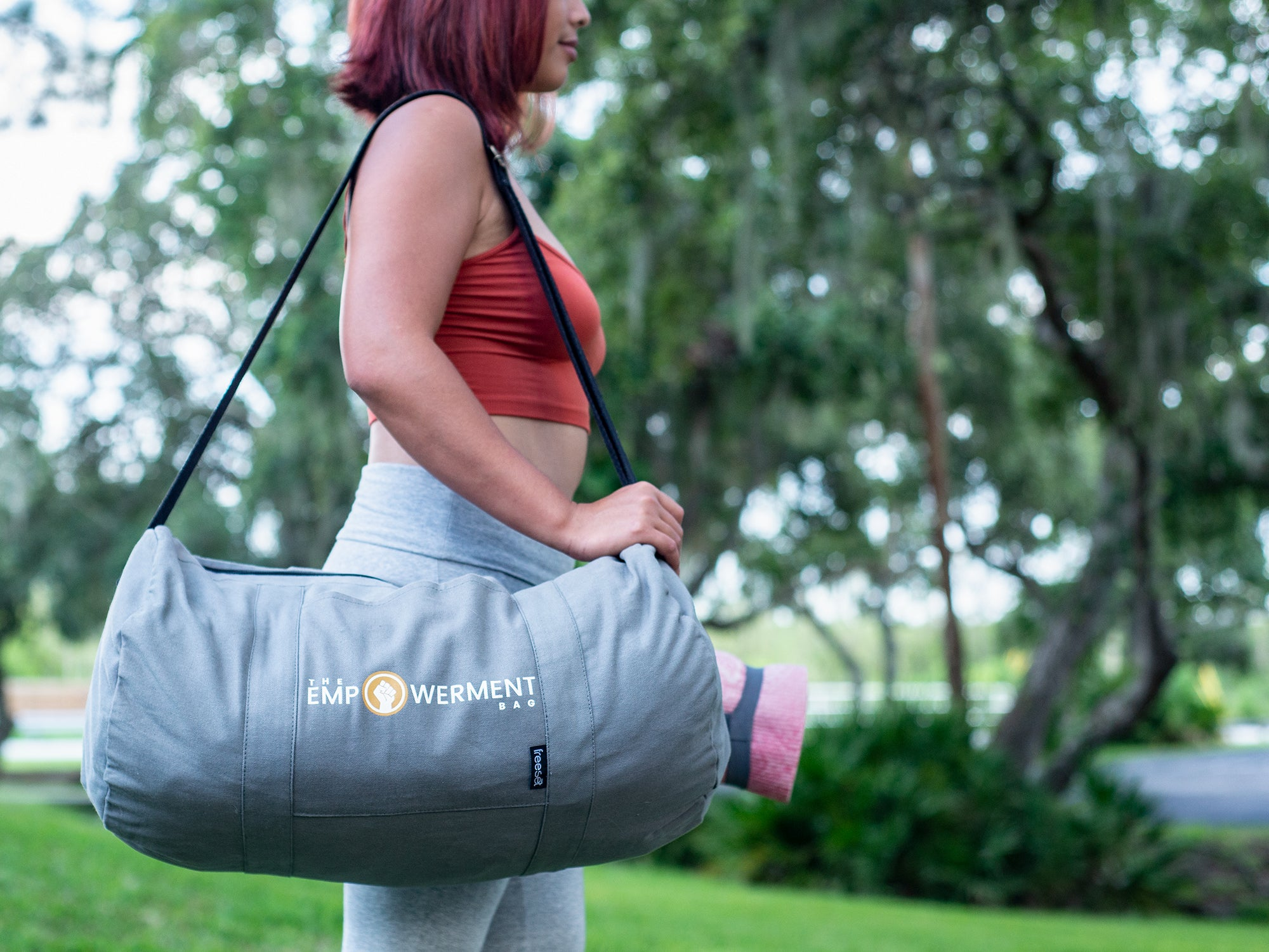 Young fitness enthusiast taking duffel bag to the gym