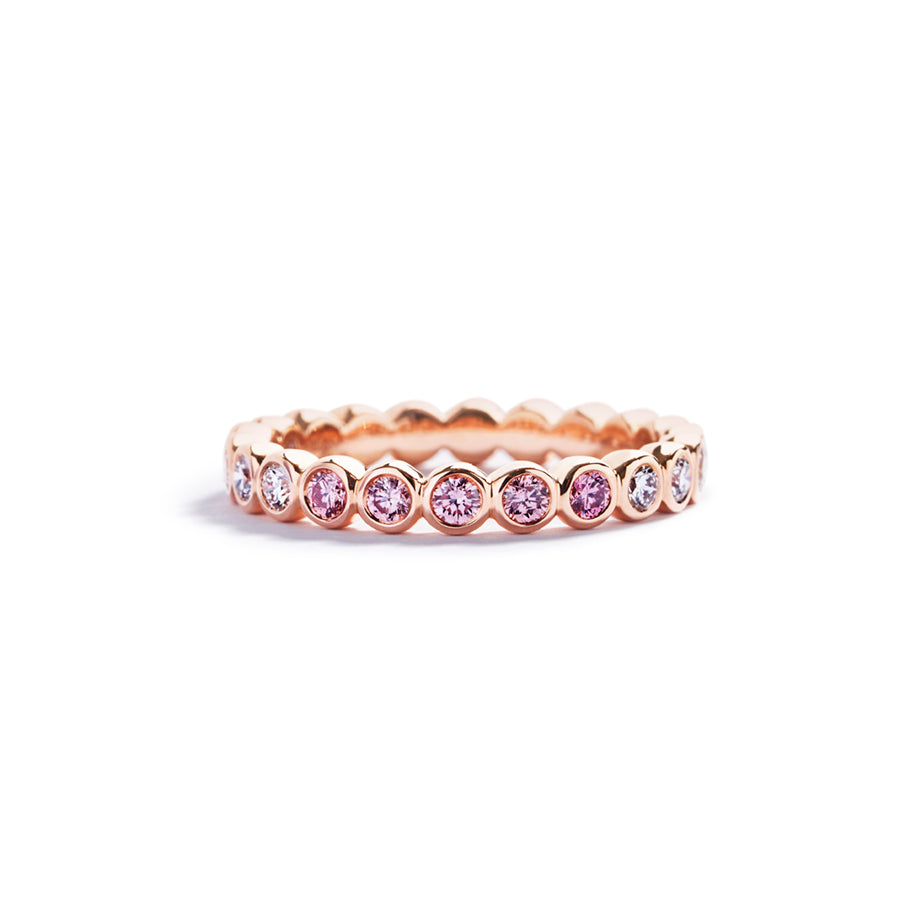 Alliancering med 0,65 ct. brillanter og Argyle Pink diamanter