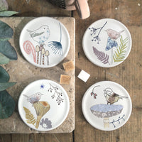 set of four toadstool and bird coasters