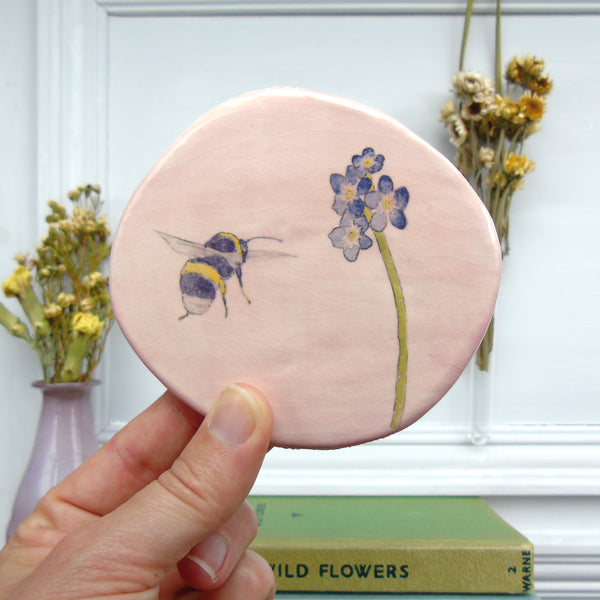 handmade ceramic pink bee and forget me not plaque