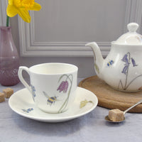 Bee and spring flowers china teacup and saucer