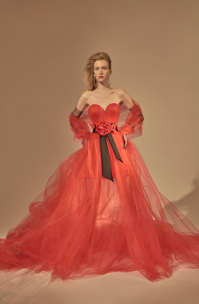 TULLE GOWN WITH DRAPERY ON CORSET AND RED FLOWER AT THE WAIST