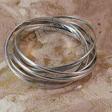 Sarah 9 pc Set Entangled Stainless Steel Partywear Bangles/Cuff/Bracelet for Girls and Women