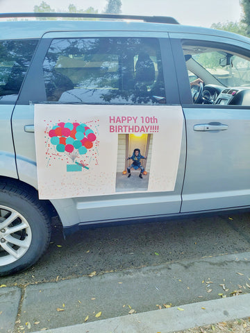 """car with a """"happy birthday"""" banner"""