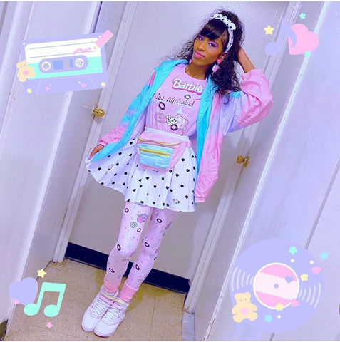 African american woman modeling pastel 90's outfit