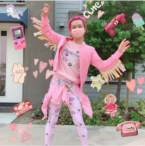 Pink haired Asian man modeling pink outfit