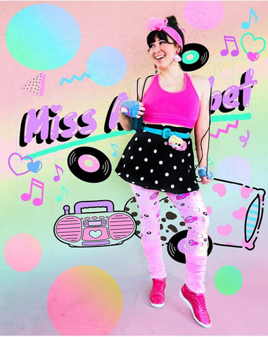 femme wearing pink boombox leggings with 80's Miss Alphabet background