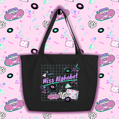 black tote bag with 90's barbie boombox miss alphabet logo