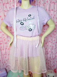 Miss Alphabet t-shirt modeled on a mannequin with a peach tutu skirt