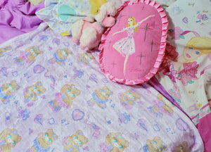 bed with pink ballerina bear blanket and barbie pillows