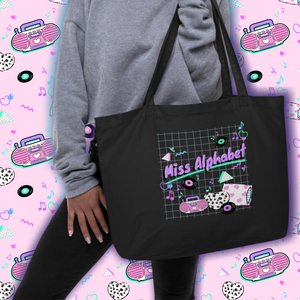 woman modeling 90's barbie boombox miss alphabet logo tote bag