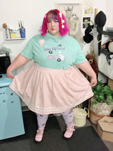 Load image into Gallery viewer, Femme with pink hair modeling mint green Miss Alphabet t-shirt and Barbie boombox leggings