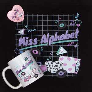 mug and tote bag with pink miss alphabet barbie boombox logo motif