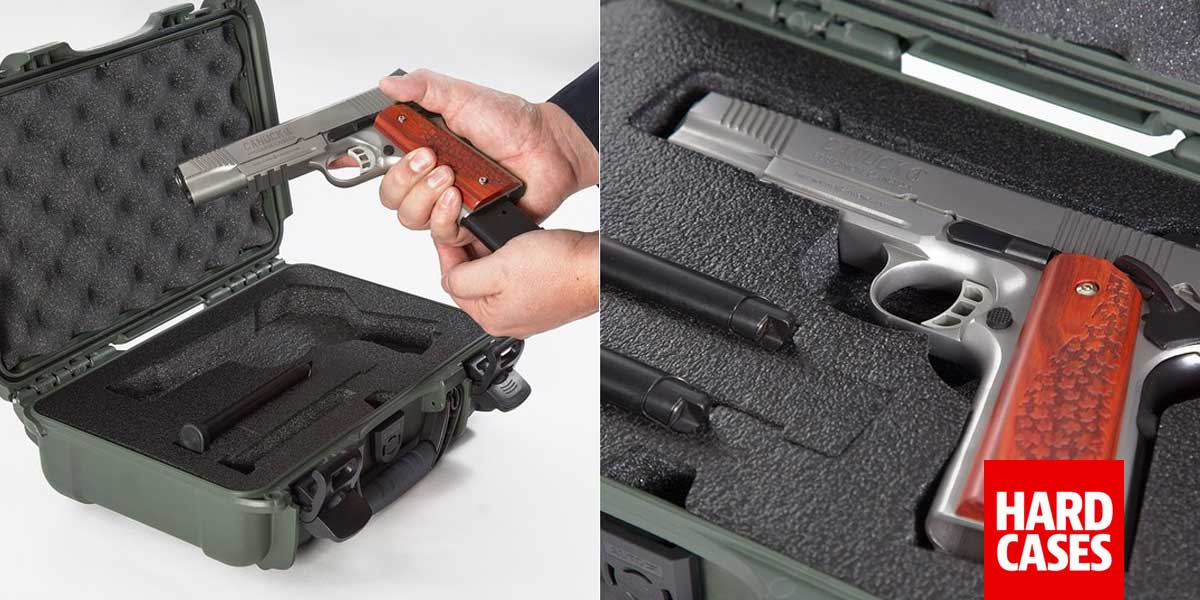 Man holding a classi handgun and placing it in a Nanuk 909 Hard Case