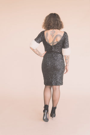 black sequin dress with fur trim