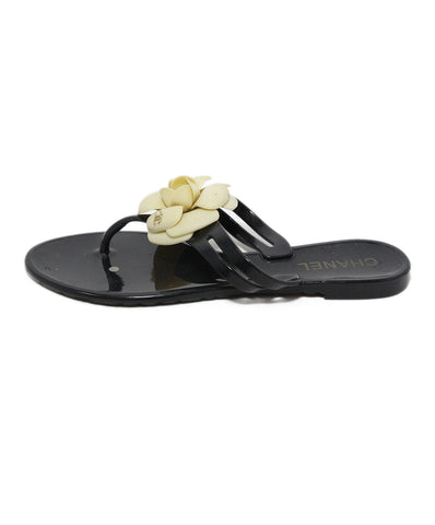 Chanel black plastic ivory floral detail slides 1