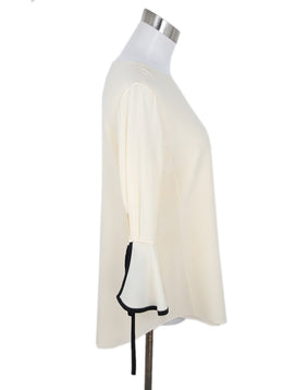 Chloe Cream Silk Blouse with Black Trim on Wrist 2