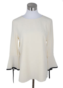 Chloe Cream Silk Blouse with Black Trim on Wrist 1